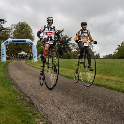 Two penny farthing riders completing their ride